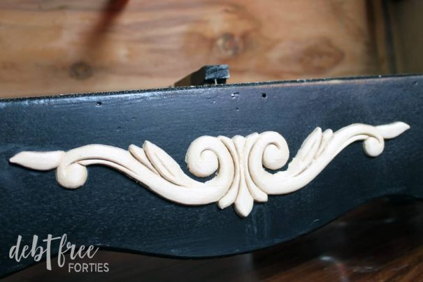 Use wood glue to add wood appliques to your furniture to create a new look.