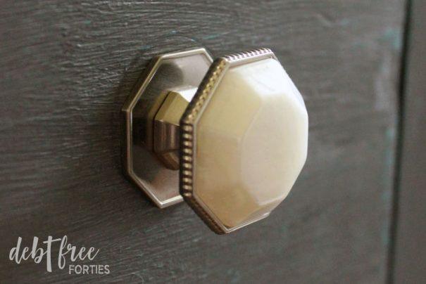Add your new knobs to your chalk paint furniture. You're almost done!