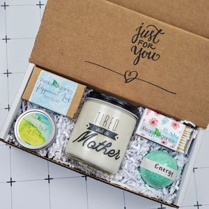 candle and spa items in a box