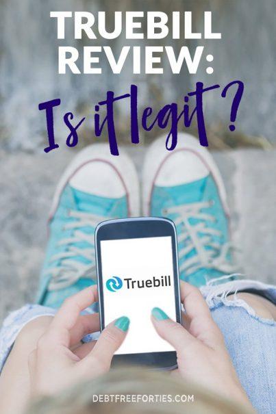 overhead shot of woman holding phone with Truebill logo on screen